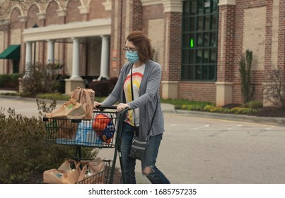 Raleigh, NC/United States- 03/27/2020: A woman exits a grocery store wearing a mask amid the coronavirus epidemic.
