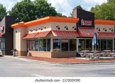 Raleigh, NC/United States- 09/04/2018: The outside of a Dunkin Donuts retail location with drive thru.