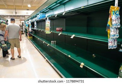 Raleigh, NC/United States- 09/13/2018:  Grocery store shelves are completely void of bottled water ahead of an approaching hurricane.
