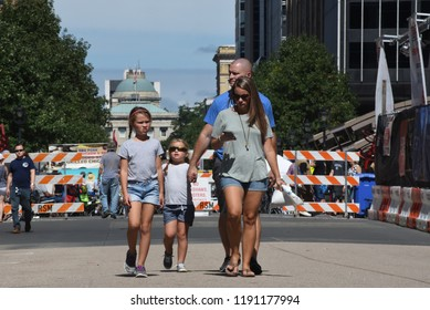 Raleigh, NC/United States- 09/29/2018: A young family walks down a blocked off Fayetteville Street during a BBQ competition in downtown Raleigh.