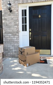 Raleigh, NC/United States- 10/03/2018: Amazon packages at the front door of a residence.