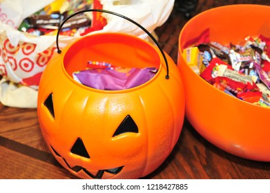 Raleigh, NC/United States- 10/31/2017: Jack-O-Lantern and bags full of Halloween candy