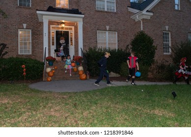 Raleigh, NC/United States- 10/31/2018: Costumed children go trick-or-treating on Halloween night.