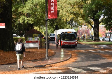 Raleigh, NC/United States- 11/06/2018: A bus picks up students near north campus at NC State University.