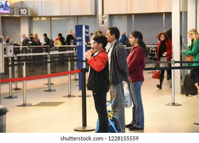 Raleigh, NC/United States- 11/12/2018: A Muslim family watches as a loved one enters security and then towards the boarding gates at RDU international airport.