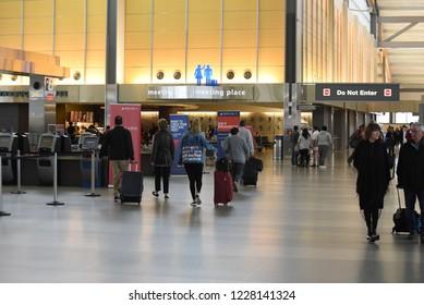 Raleigh, NC/United States- 11/12/2018: Passengers walk towards the departure gates at RDU International airport.