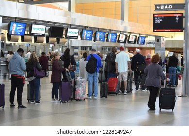 Raleigh, NC/United States- 11/12/2018: Passengers wait to check bags in a long line at RDU International airport.