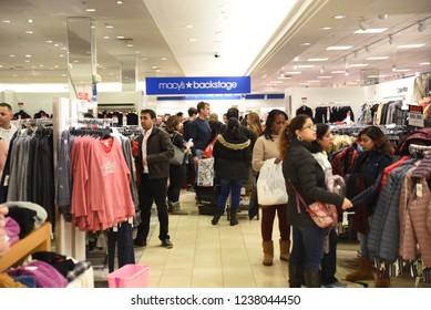 Raleigh, NC/United States- 11/23/2018: Hordes of Holiday shoppers examine discounted apparel at Macy's on Black Friday.
