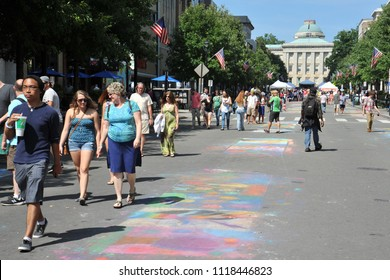 Raleigh, NC/US- 09/25/2013: Visitors to downtown Raleigh walk past chalk art along Fayetteville St.