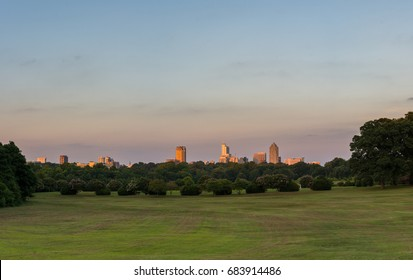 Raleigh, North Carolina Skyline from Dorothea Dix city park at sunset