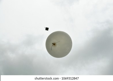 RALEIGH, NORTH CAROLINA, USA - APRIL 15. 2018: NCSU student members of the Soundings Club launch weather balloons in front of impending severe storms