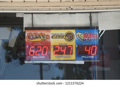 Raleigh, North Carolina/United States- 10/24/2018: Lottery signs advertising potential winnings outside of a gas station in Raleigh.