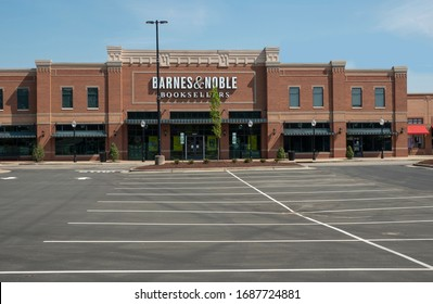 Raleigh,NC/United States- 03/28/2020: The parking lot of A Barnes & Noble retail store is completely deserted amid the coronavirus (COVID-19) epidemic.