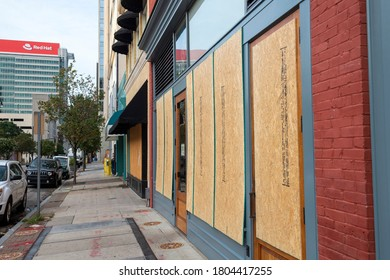 Raleigh,NC/USA 08282020 - Local business in Downtown Raleigh board up store fronts in preparation for Black Lives Matter Protest. A curfew has been put in place for the weekend.