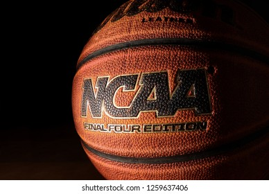 RALEIGH,NC/USA - 12-13-2018: An NCAA Final Four Edition basketball on hardwood with dark background