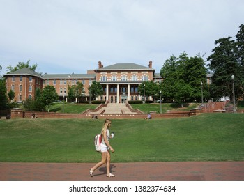 RALEIGH,NC/USA - 4-25-2019: A female student walks on campus of North Carolina State University in Raleigh
