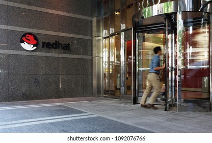RALEIGH,NC/USA - 5-11-2018: An employee enters the Red Hat headquarters building in downtown Raleigh, NC