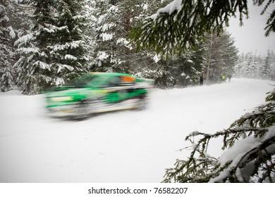 Rally Car blasting through a snowy road