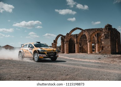 Rally car Passing by Agios Sozomenos in Cyprus for the ERC Cyprus Rally 2018