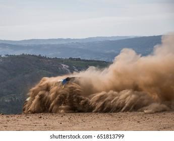 Rally car raising the dirt cloud