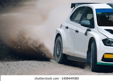 Rally off-road car make a turn with the clouds and splashes of sand, gravel and dust during rally championship