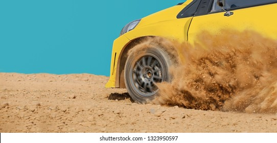 Rally racing car in dirt track.