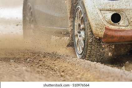 Rally racing car increase speed in muddy road