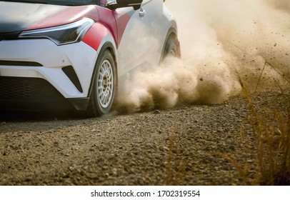 Rally racing car on dirt road.