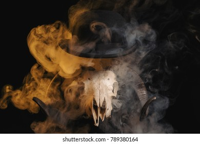 Ram skull with horns and a bowler hat on a smoky background