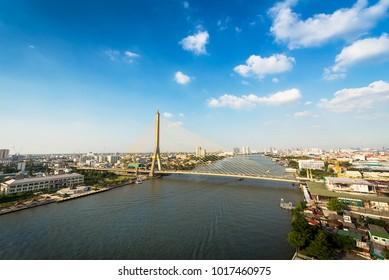 Rama 8 bridge at Chaopraya river on cityscape in Bangkok Thailand