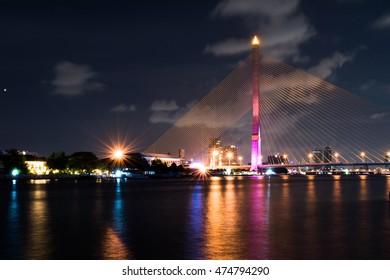 Rama VIII Bridge at night in Bangkok and Chopraya river, Thailand