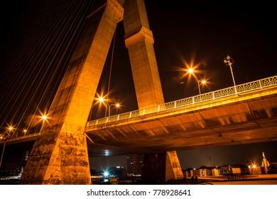 The Rama VIII Bridge at night.The Rama VIII Bridge is a cable-stayed bridge crossing the Chao Phraya River in Bangkok, Thailand.