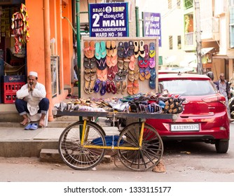 Ramachandrapuram, Bangalore/India- January 28, 2019: A street vendor's movable cart with ladies' footwears