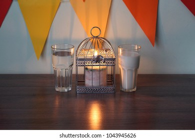Ramadan 2018. milk and water for iftar and suhoor. candle lights