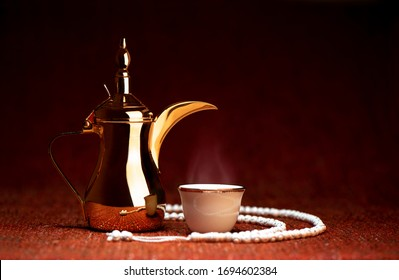 Ramadan - Arabian coffee with golden dallah on a dark red background