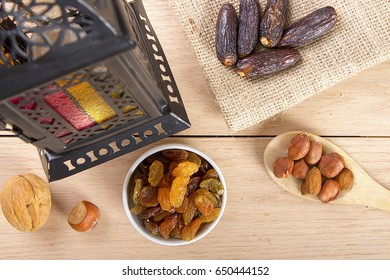 Ramadan Atmosphere - Collection of Ramadan Fruits and Nuts with Lantern on wooden table