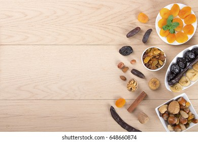Ramadan Background - Collection of Ramadan Fruits and Nuts on wooden table with blank area