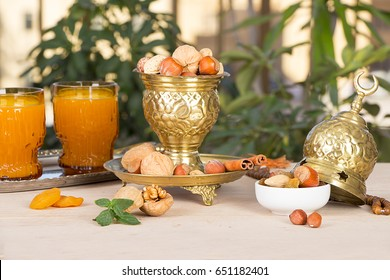 Ramadan Background - Collection of Ramadan Nuts and Qamar El Din (Apricot Juice) on wooden table