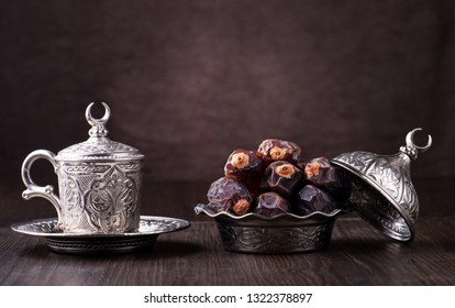 Ramadan background with dates and arabic coffee cup