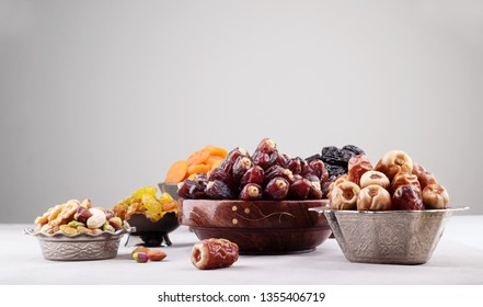 Ramadan background with dates fruit apricots prunes and mixed nuts