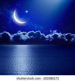 Ramadan background - moon and star with reflection in sea, holy month. Elements of this image furnished by NASA