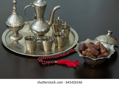 Ramadan concept: Dates, zam zam water and rosary on brown table