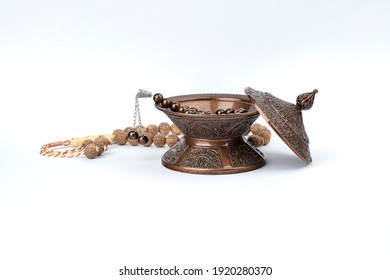 Ramadan concept with prayer beads and plate.