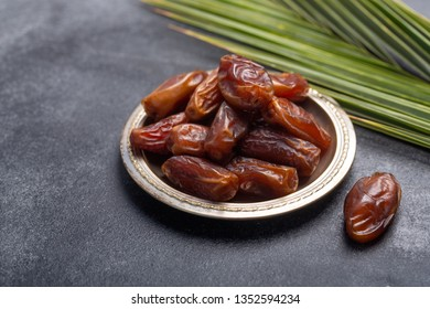 Ramadan dates is traditional food for iftar in islamic world. Dark background