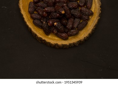 Ramadan Food Background with copy space - Top View of a black wooden table with dried dates - ready for iftar (breakfast) in Ramadan
