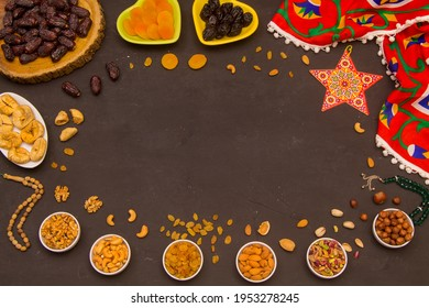 Ramadan Food Background with copy space - Top View of a black wooden table with different kinds of Arabian food ( dried dates and nuts) ready for iftar (breakfast) in Ramadan