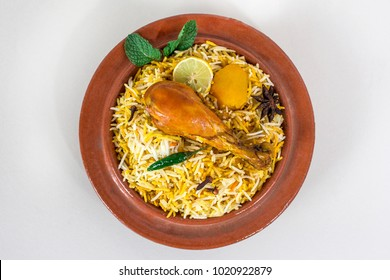 Ramadan food, Spicy chicken biryani in traditional soil bowl.