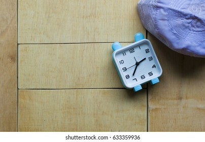 ramadan kareem, alarm clock suhoor, wood background