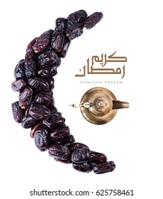 Ramadan kareem with arabic coffee pot and dates fruit arranged in shape of crescent moon