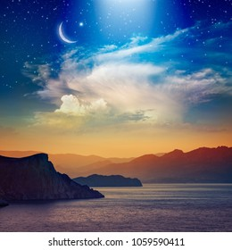 Ramadan Kareem background with crescent, stars and glowing clouds above serene sea and mountains.  Elements of this image furnished by NASA